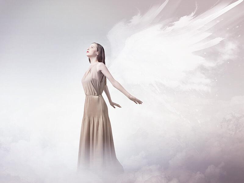 angel-woman-clouds-wings